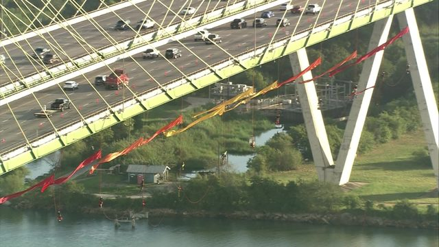 LIVE STREAM: Greenpeace protesters hang from Fred Hartman Bridge