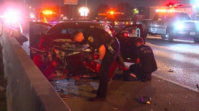 Woman struck by car while crossing North Freeway