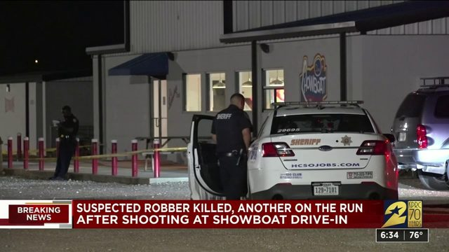 1 robber dead, another at large after shooting at Showboat Drive-in
