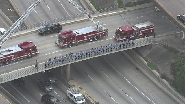 Procession held for HFD firefighter Kenneth Stavinoha, who died after…