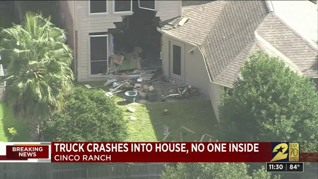 Truck leaves hole in Katy home after crashing through it