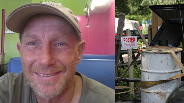 Body found in buried barrel during search for missing man, officials say