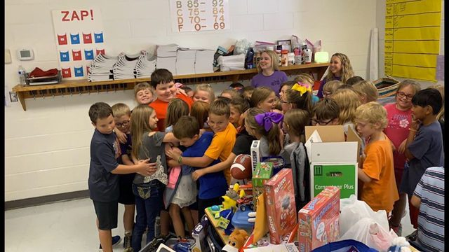 Classmates surprise 8-year-old boy with new toys after losing home in fire