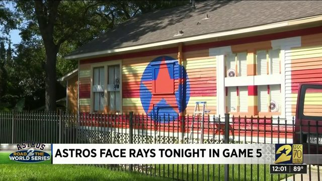 Astros superfans paint home with team colors