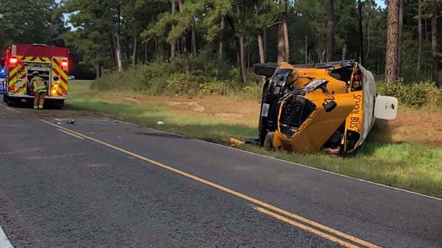 Football team on board when school bus rolls over in crash, officials say