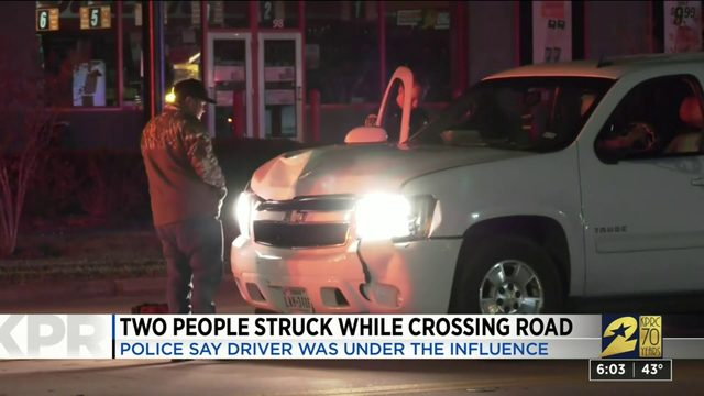 Two people struck by car while crossing road